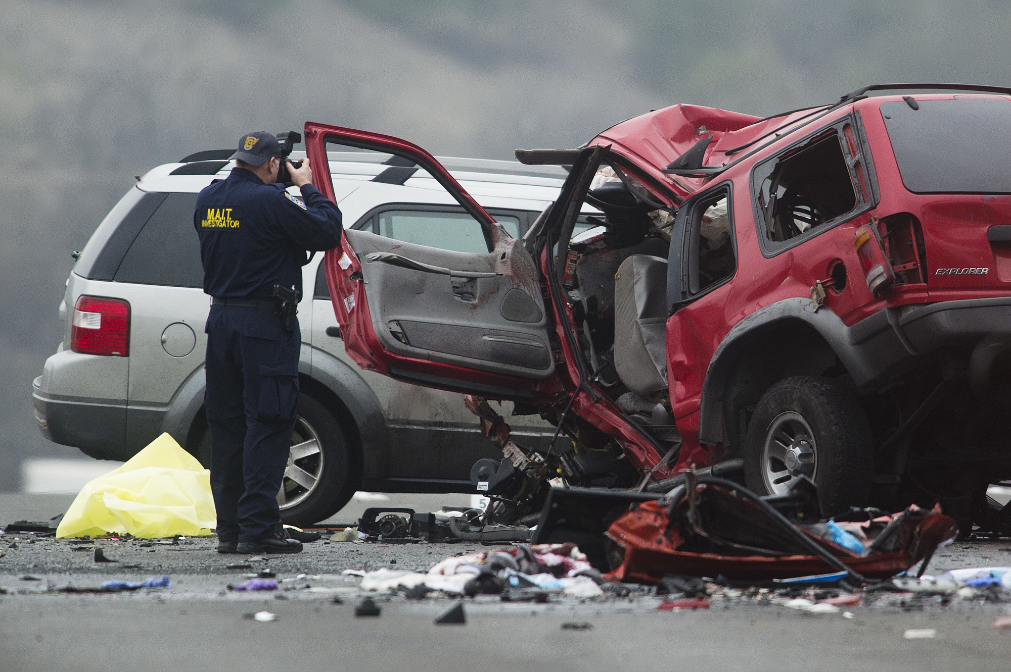 Officials investigate the scene of a multiple vehicle accident where 6 people were killed on the westbound Pomona Freeway in Diamond Bar, Calif. on Sunday morning, Feb. 9, 2013. Authorities say a wrong-way driver caused the pre-dawn crash that left six people dead.  (AP Photo/San Gabriel Valley Tribune,Watchara Phomicinda) MAGS OUT, NO SALES MANDATORY CREDIT